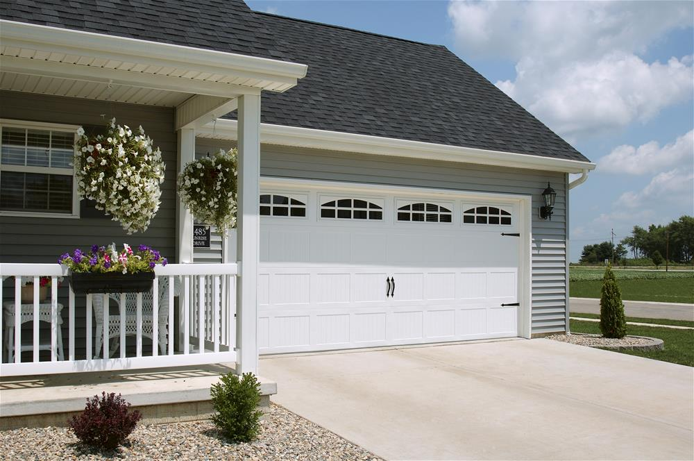 : white wood insulated garage doors
