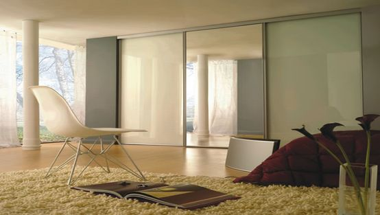 contemporary bedroom furniture mirrored fitted wardrobes ideas with modern bedroom chairs and fur rug