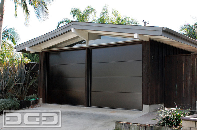 : black solid wooden carriage garage doors modern design for contemporary residential home