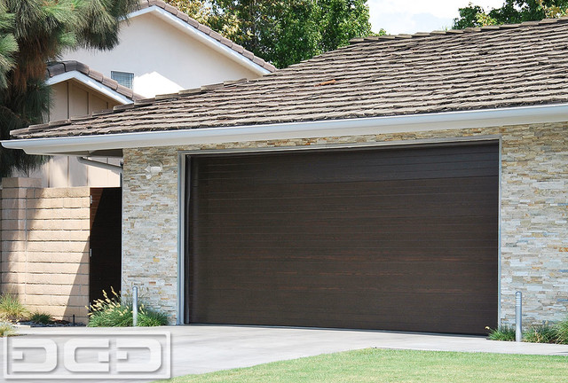: modern wood grain garage doors rolled up design for contemporary house designs garage