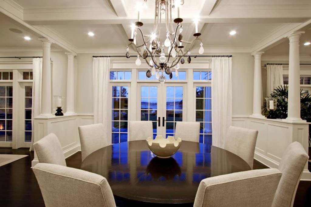 : formal dining room decorating ideas with shining chandelier and black round table using white chairs